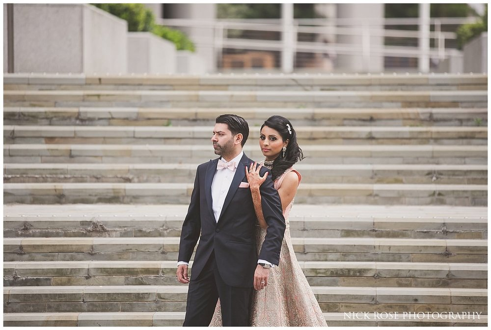 Hindu bride and groom photograph on steps at Canary Wharf in London