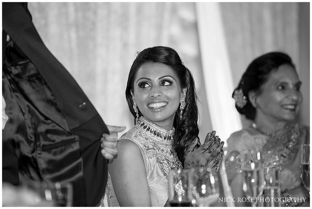 Bride smiling during an Indian wedding reception in Canary Wharf London