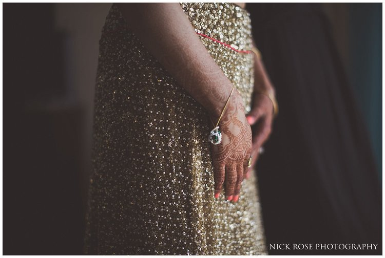Asian bride with a gold skirt getting ready for a destination Hindu wedding in Dubai at Sofitel Palm