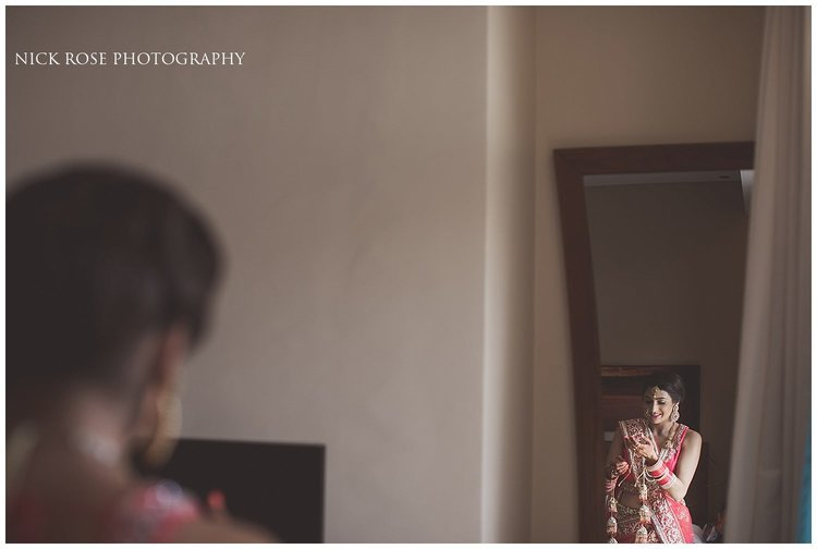 Bride getting dressed for a Hindu beach wedding in Dubai