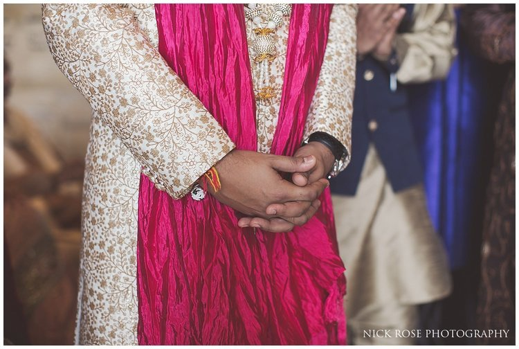 Hindu groom with red scarf before a Destination beach wedding at the Sofitel Palm Dubai