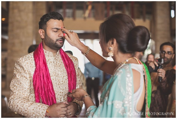 Groom being blessed by Indian relative before a Hindu wedding in Dubai