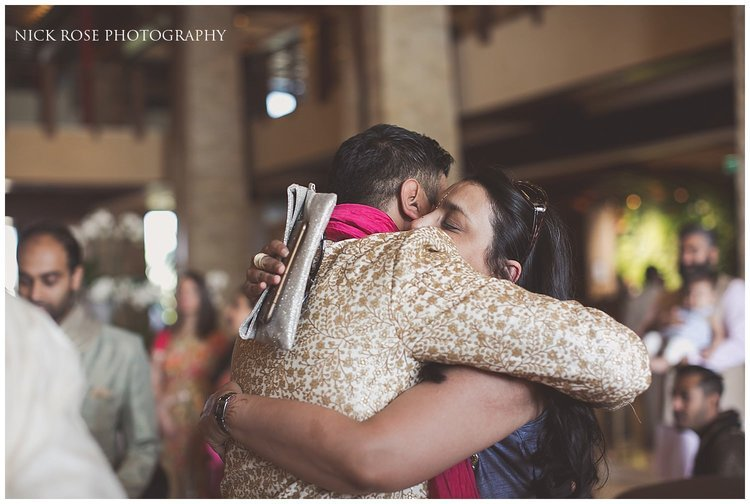 Hindu groom hugging a guests before a Dubai destination wedding