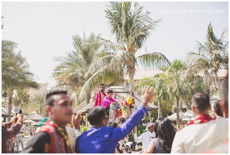 Guests dancing at an Asian destination wedding Barrat in Dubai