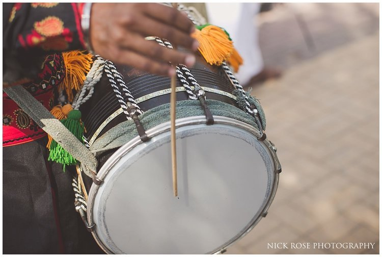 Drums being played for a Hindu wedding entrance at a Sofitel Palm Dubai beach ceremony
