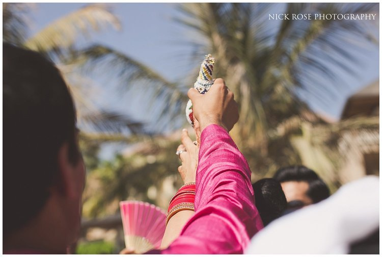 Hindu priest Kamal Pandey greeting the groom at a destination Indian wedding in Dubai