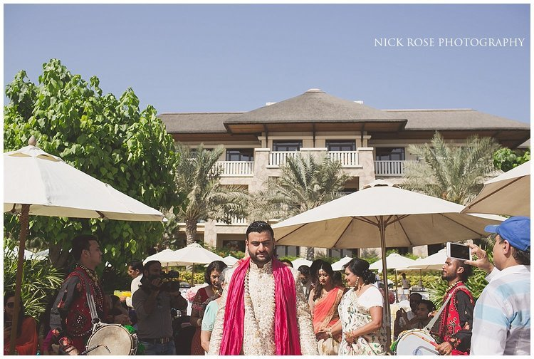 Groom walking to the Hindu mandap for a Sofitel Palm destination wedding in Dubai