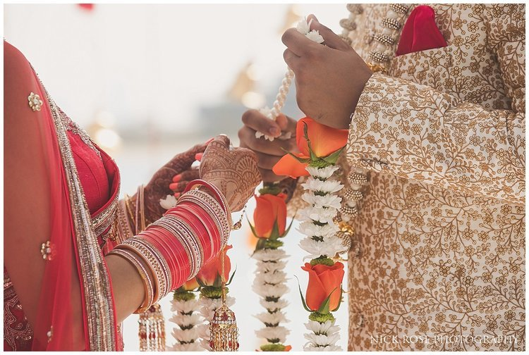 Indian bride and groom exchanging garlands during a destination Hindu wedding ceremony in Dubai
