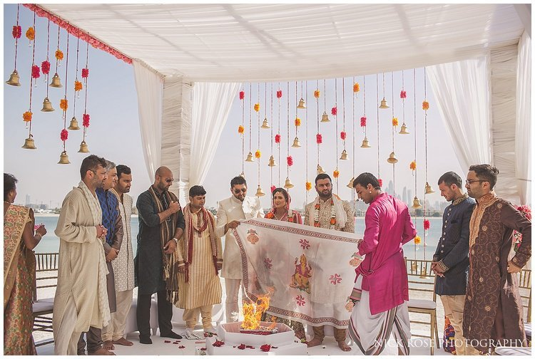 Asian wedding taking place on the beach of the Sofitel Palm Dubai