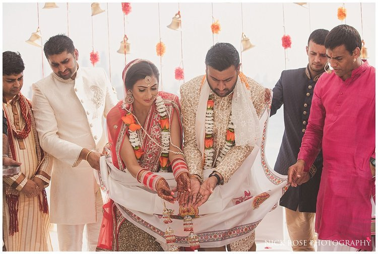 Bride and groom performing a Hindu wedding ceremony ritual