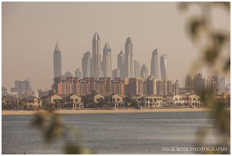 View of the Dubai city skyline from the beach at the Sofitel Palm Dubai