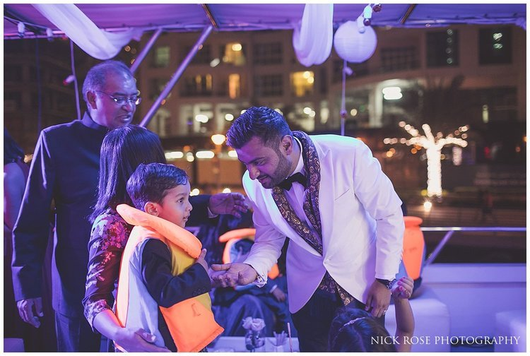 Young boy wearing a lifejacket for a private yacht wedding reception in Dubai
