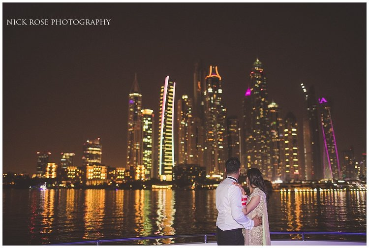 Asian destination wedding couple night portrait in front of the Dubai city skyline