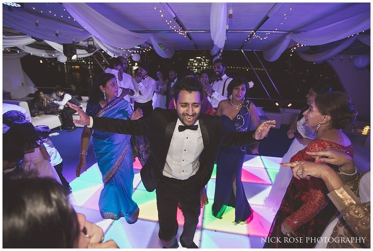Guest in tuxedo dancing at a Dubai destination wedding