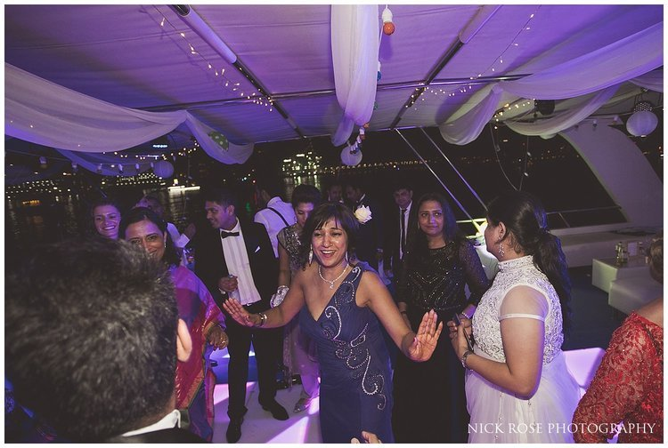 Guests dancing during an Indian wedding reception in Dubai