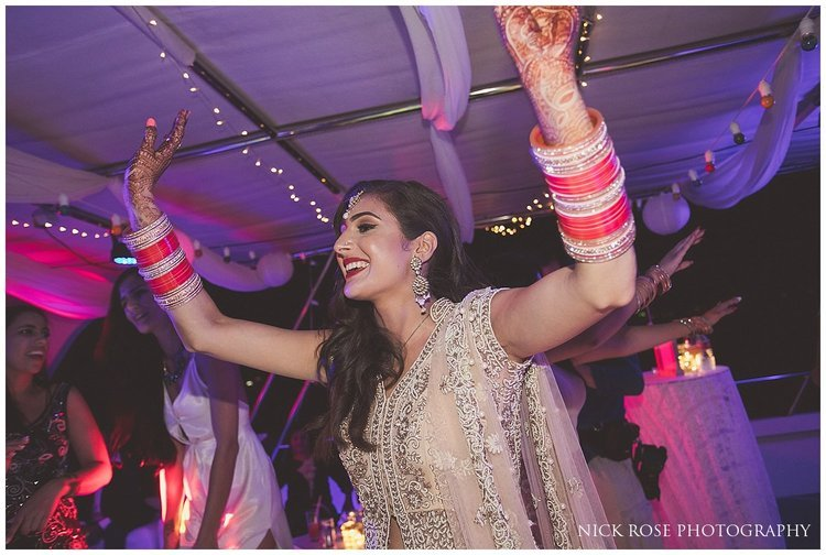 Bride with her hands in the air at a destination wedding in Dubai