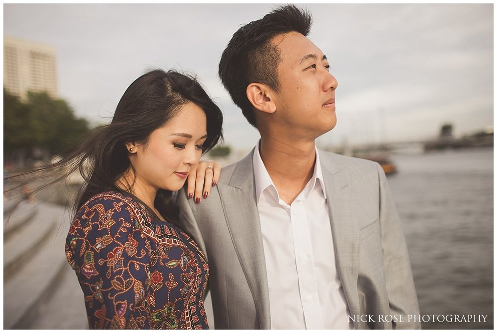 Pre wedding photography couple standing by the water at Marina Bay in Singapore