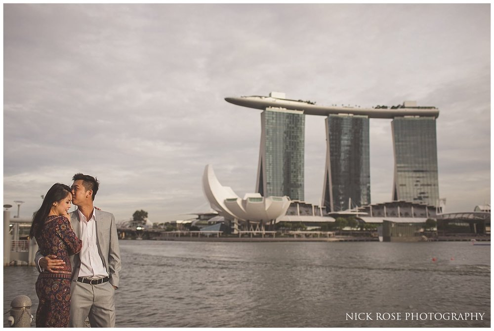 Couple embracing in front of the Marina Bay Sands Hotel for a Singapore pre wedding photography shoot
