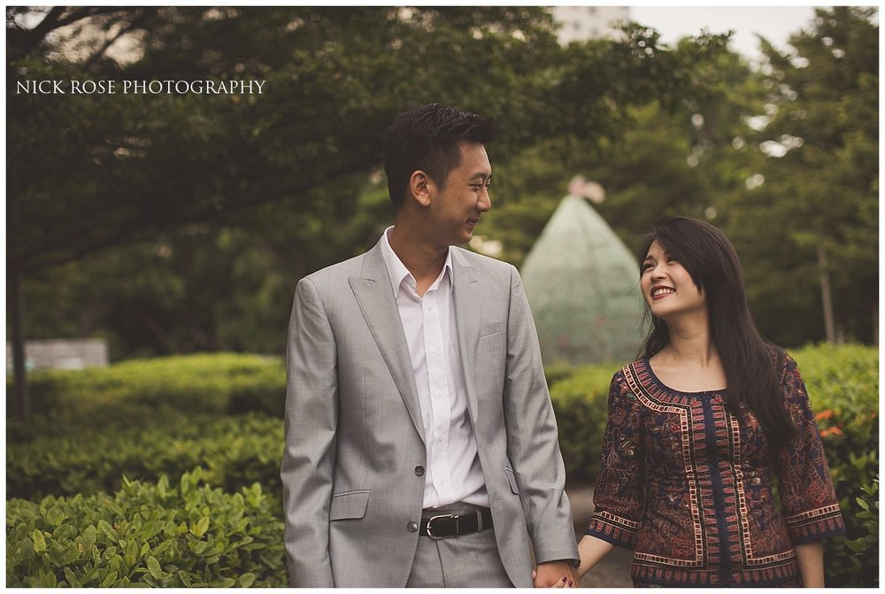 Pre wedding couple holding hands and looking at each other during a Singapore pre wedding photography shoot at Marina Bay