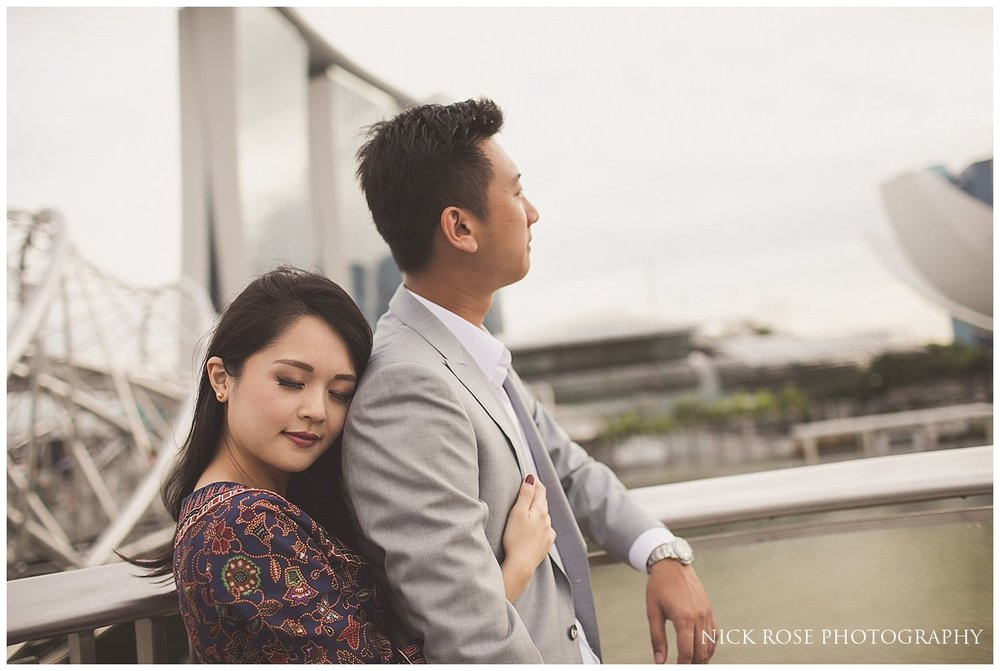 Woman holding her fiance during a romantic pre wedding photography shoot at Marina Bay in Singapore