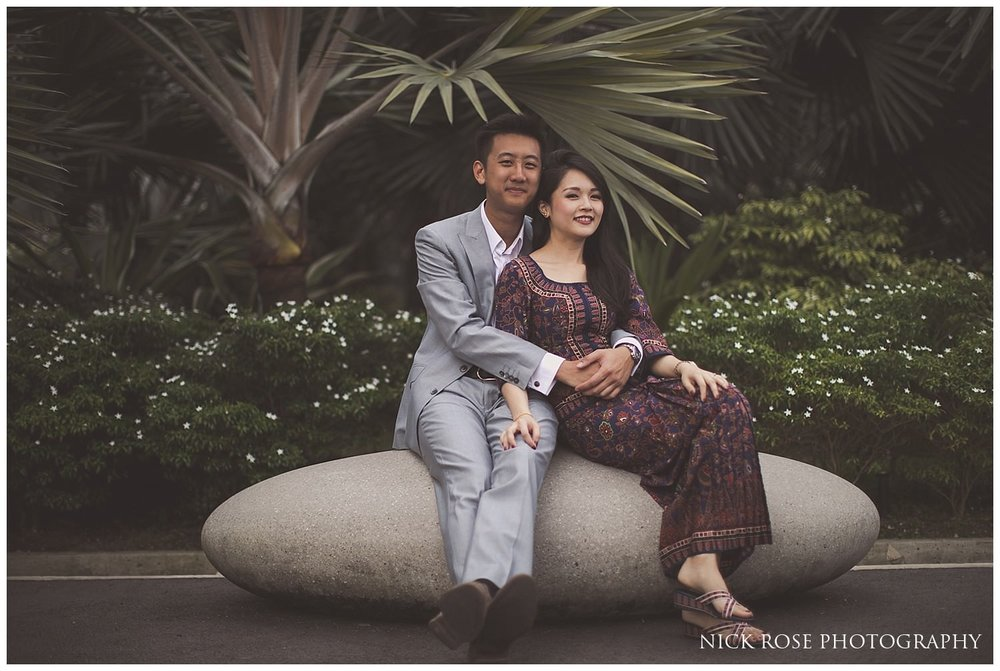 Singapore couple sitting on a rock during a pre wedding photography shoot at Garden by the Bay in Singapore
