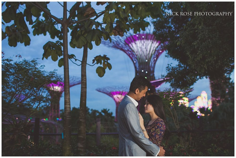 Night time pre wedding photograph of couple embracing at Gardens by the Bay in Singapore
