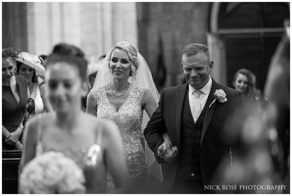 Bride walking down the aisle in St Mary's Church in Tickhill