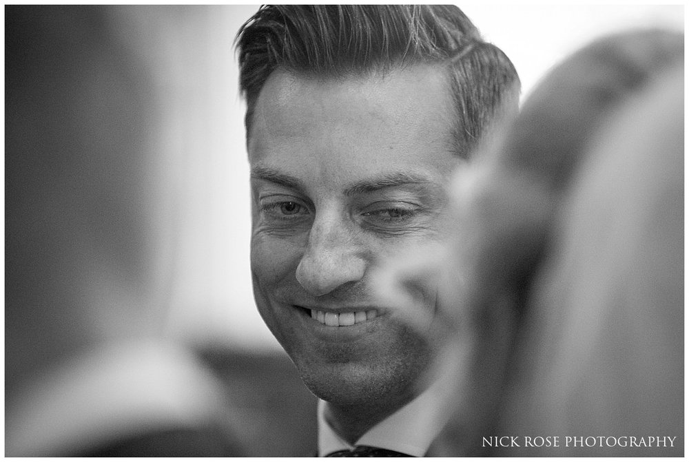 Groom looking at bride during a south Yorkshire wedding ceremony at St Mary's Church