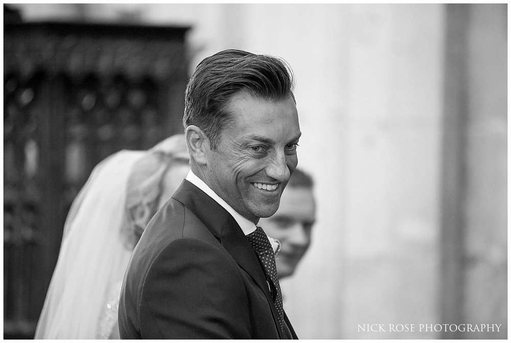 Groom smiling during the wedding ceremony in St Mary's church in Tickhill