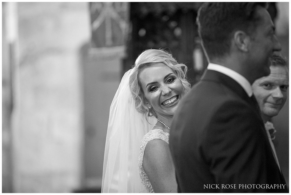 St Mary's church bride smiling during the wedding ceremony
