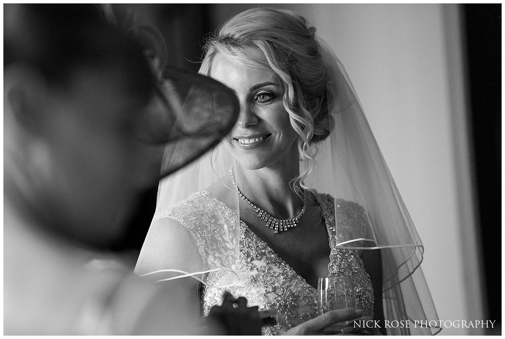 Bride standing next to natural window light at a Rudding Park wedding