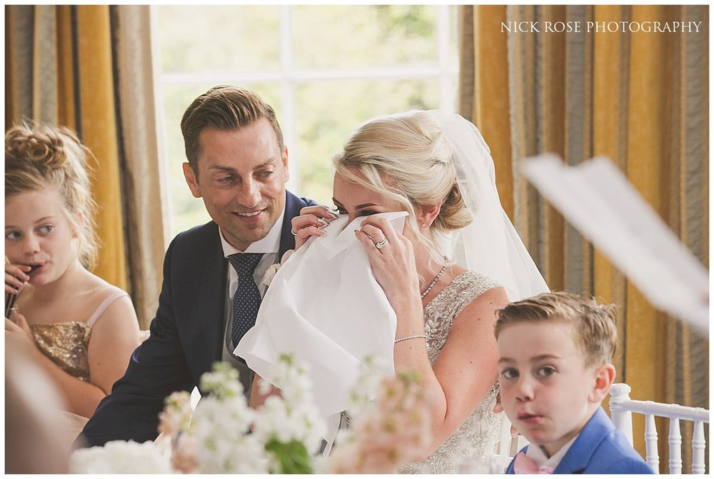 Bride wipes away a tear during the wedding speeches in the Rudding Park Hotel