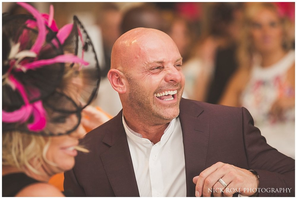 Guests laughing during the wedding speeches at Rudding Park Hotel