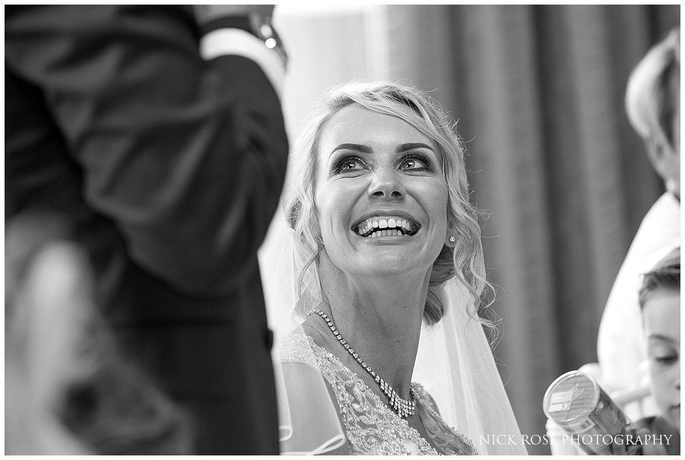 Bride smiling and listening to the Rudding Park Hotel wedding reception speeches