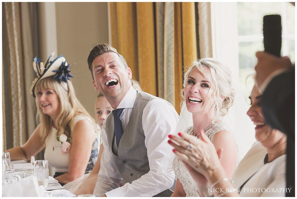 Groom and his bride laughing during the wedding speeches at the Rudding Park Hotel