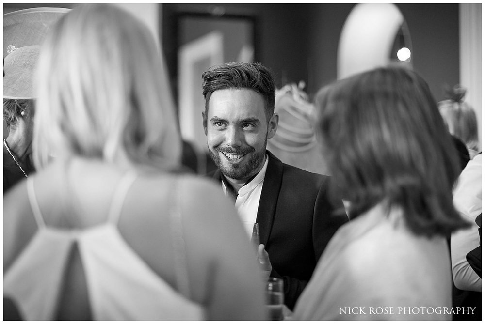 Guests mingling during a Rudding Park Hotel wedding in Harrogate