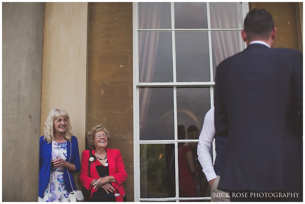 Wedding guests standing outside at Rudding Park Hotel wedding in Harrogate