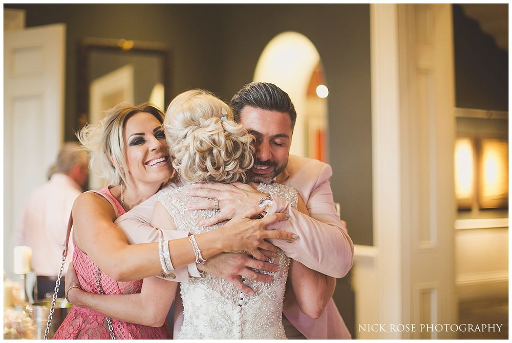 Guests hugging bride at a Rudding Park Hotel wedding reception in Harrogate