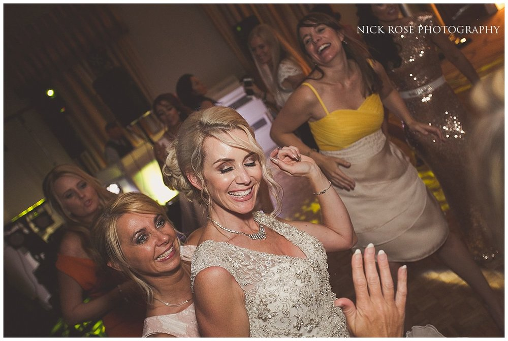 Bride on the dancefloor celebrating her North Yorkshire wedding at Rudding Park