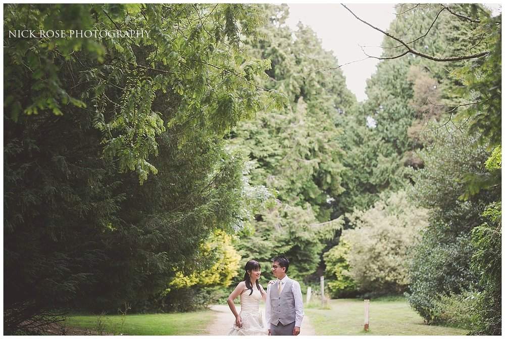 Couple embracing in the Cotswolds countryside for a UK pre wedding photography shoot