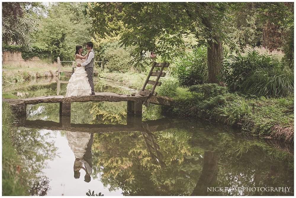 Pre wedding photography by the stream in Lower Slaughter in the Cotswolds