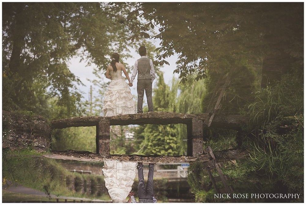 Reflection of a bride and groom in a stream during a pre wedding photography session in Lower Slaughter in the Cotswolds countryside UK
