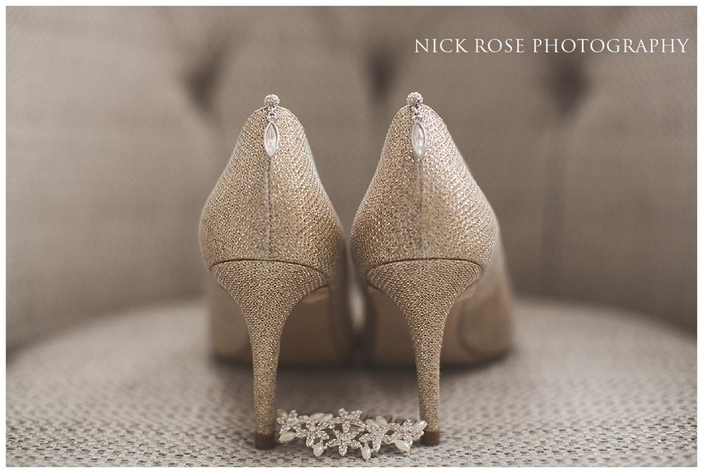 Beautiful Gold Rose wedding shoes on a chair for a Hedsor House in Buckinghamshire