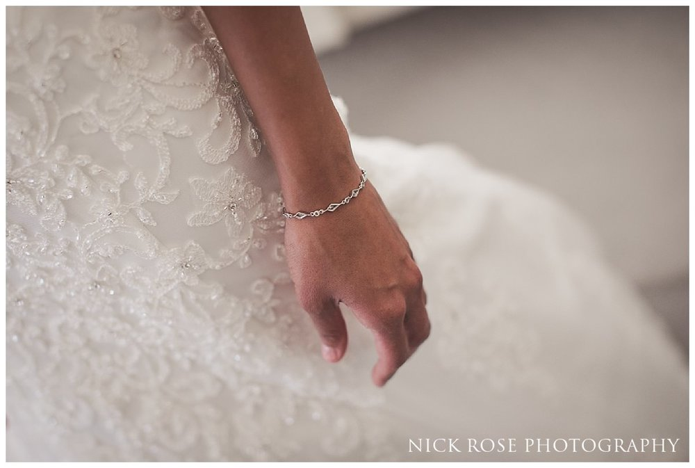 Bride's bracelet and wedding dress for a fairytale wedding at Hedsor House in Buckinghamshire