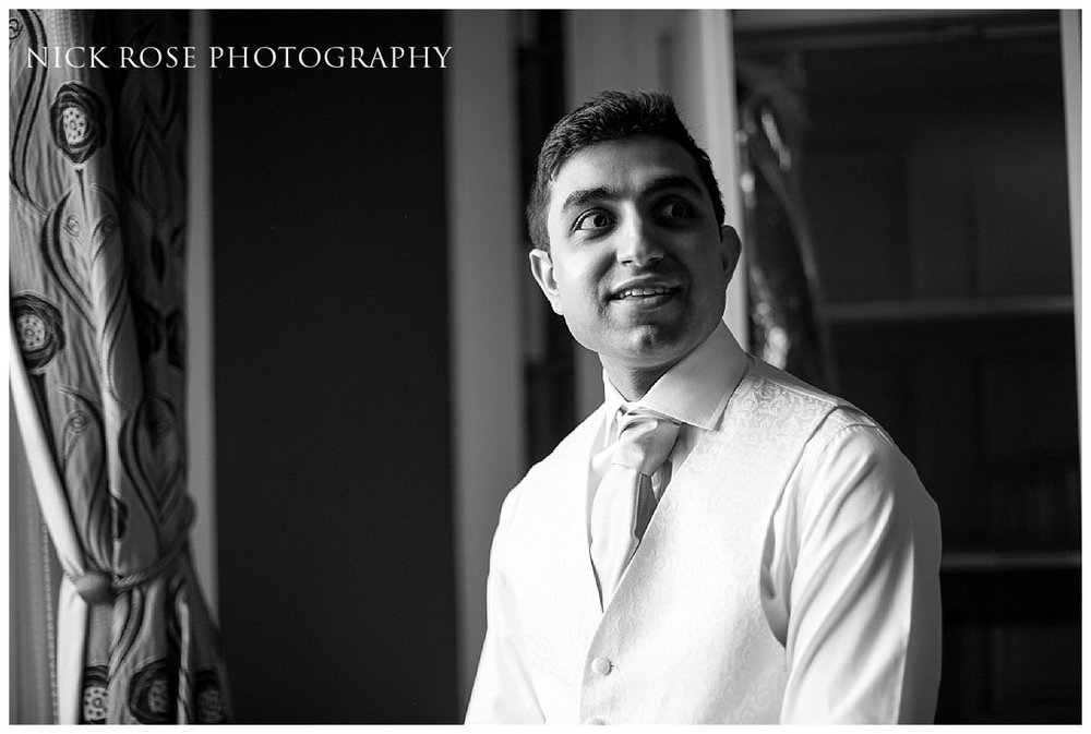 Groom getting ready before his wedding ceremony in Buck