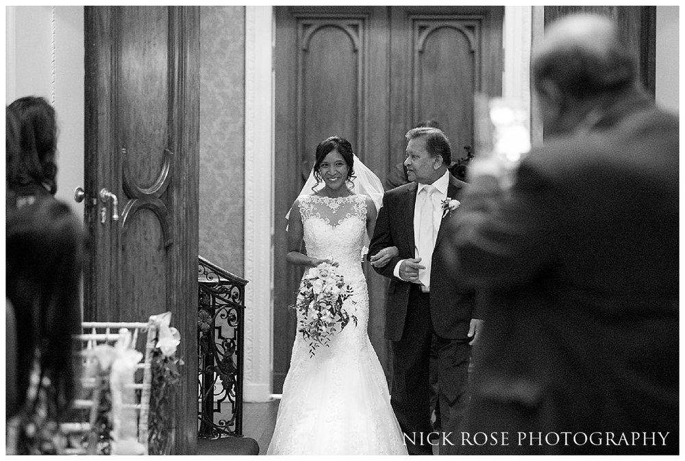 Bride walking down the isle for a Buckinghamshire wedding at Hedsor House
