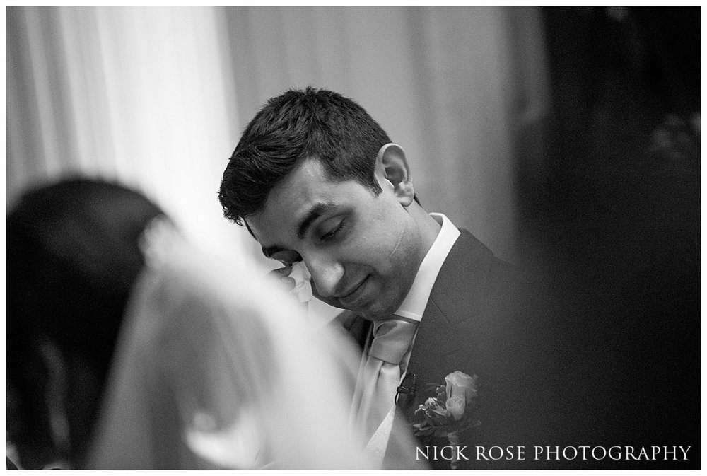 Emotional groom wipes a tear during a Hedsor House winter wedding in Buckinghamshire