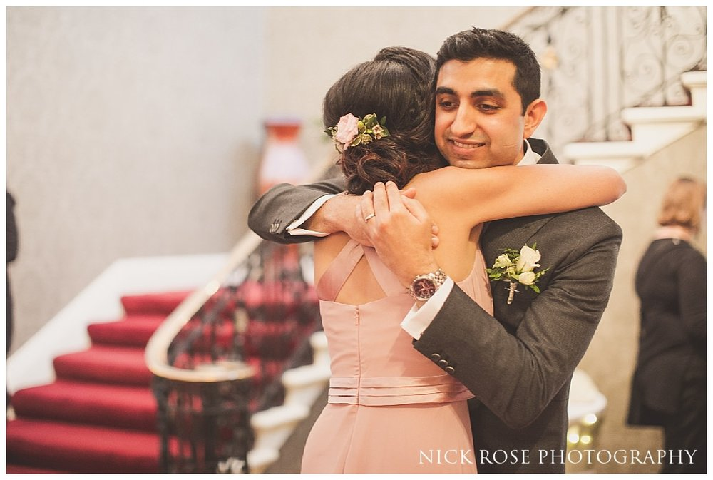 Groom hugging a bridesmaid after a Hedsor House wedding