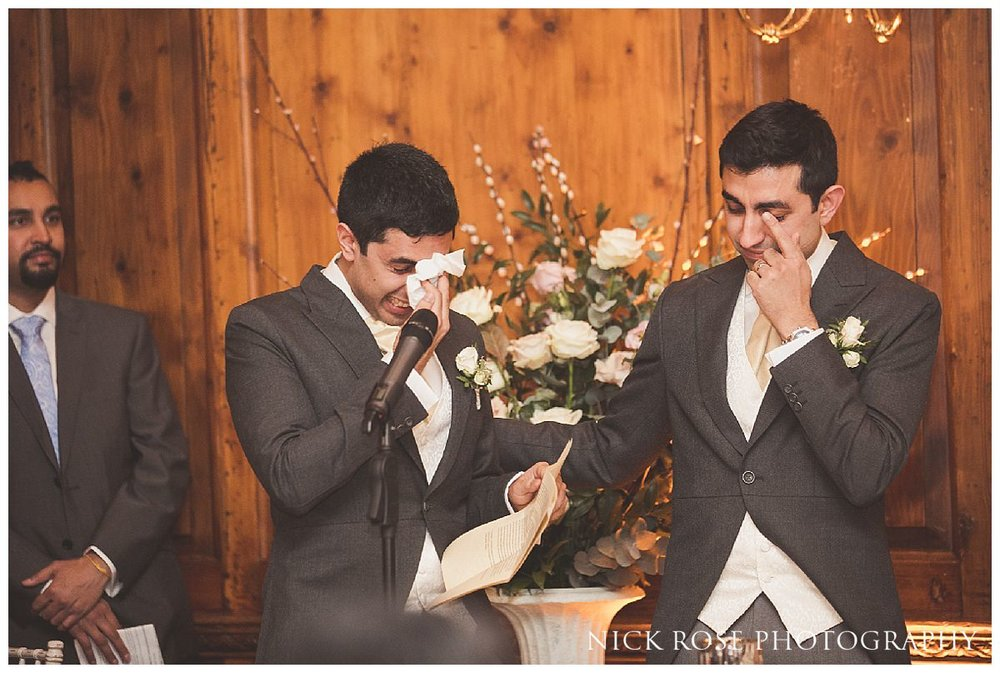Emotional groom and best man during the wedding speeches at Hedsor House