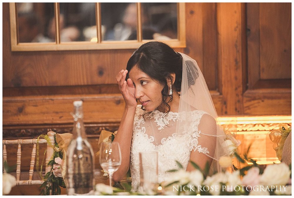 Bride wiping a tear at a Hedsor House wedding in Buckinghamshire